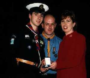 ASSL Cian Timmons Receiving his Gold Award from President McAleese with Scouting Ireland CSI Chief Commissioner Kiernan Gildea.